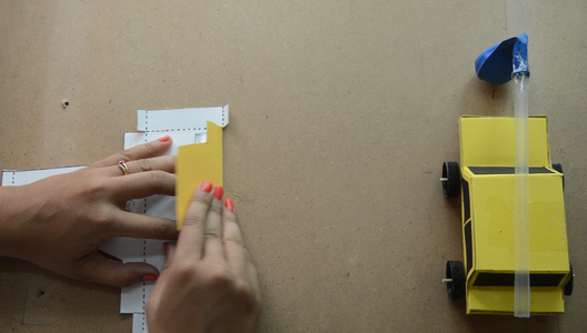 Fold the Dotted Lines Using a Scale. Now Glue the Tabs and Stick It Such a Manner That It Gives the Shape of a Car