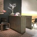 Concrete Hostess Station for Green Zone Restaurant