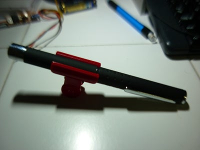 Keeping Your Laser Pointer on Easily (with Binder or Bulldog Clips)