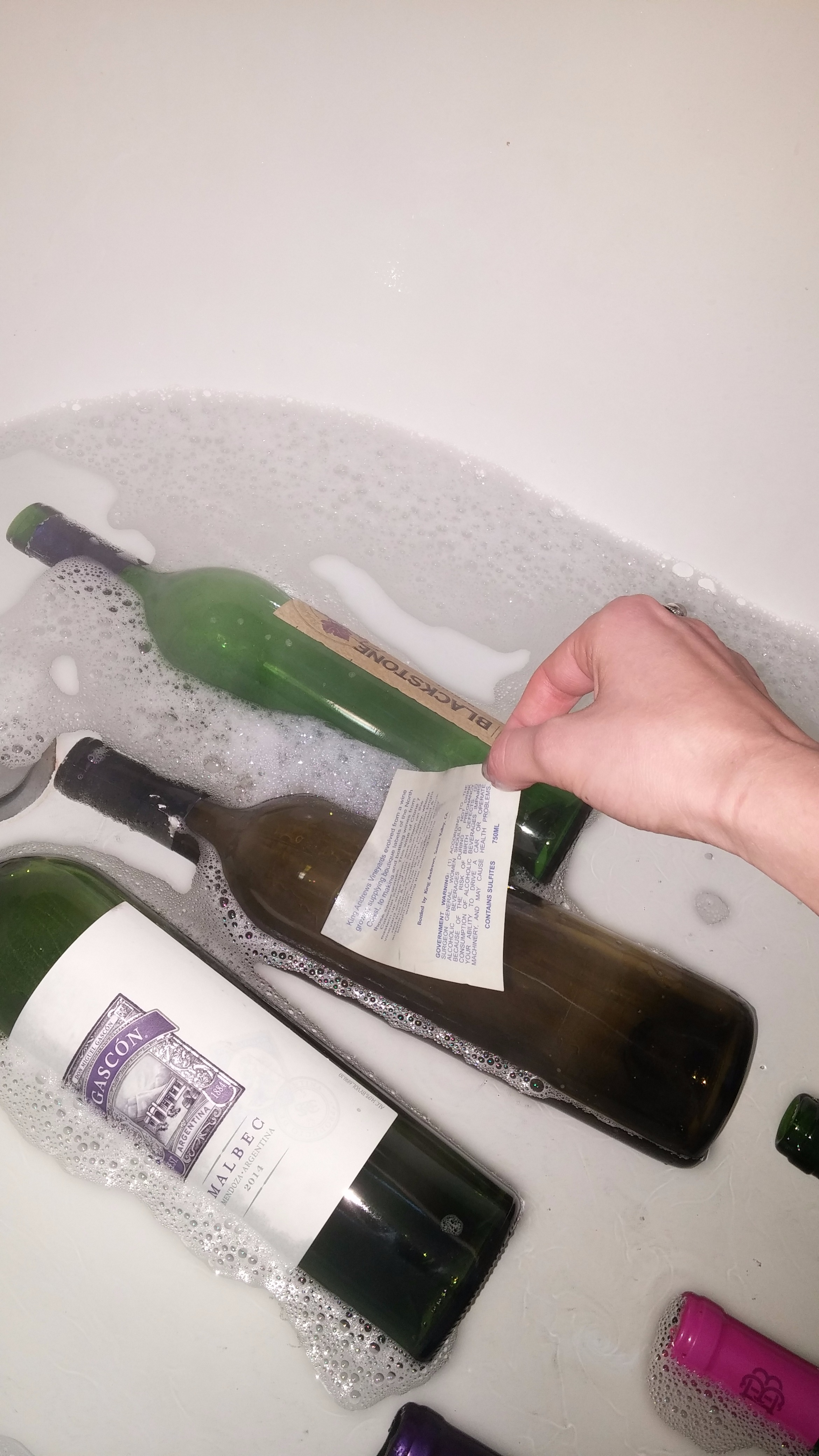 Picture of *optional* Soak the Wine Bottles in Hot Water With Dish Soap to Take Off the Labels on the Bottles.