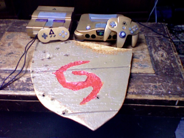 Picture of Hand Carved Deku Shield and Custom Painted SNES and N64