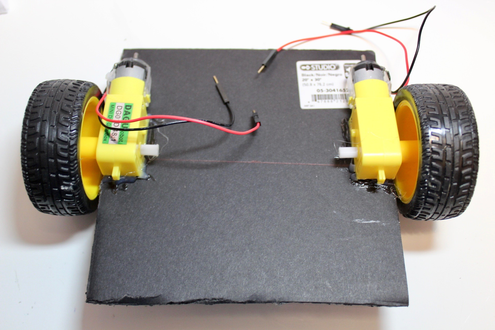 Picture of Glue the Motors to the Foam Board