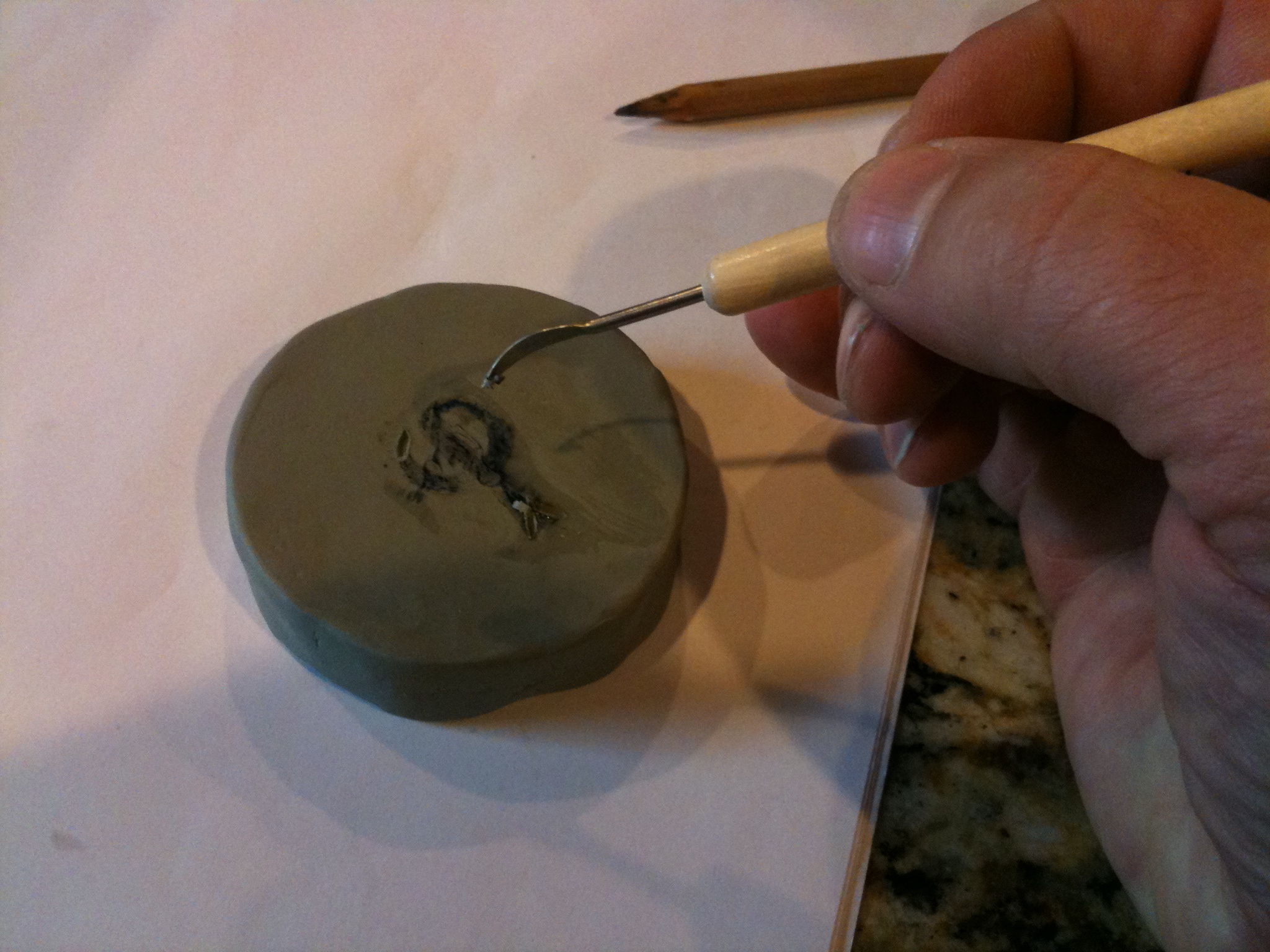 Picture of Carving the Clay Mold