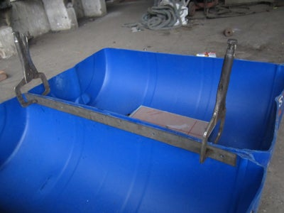 Inserting the Flat Bar to the Pvc Drum