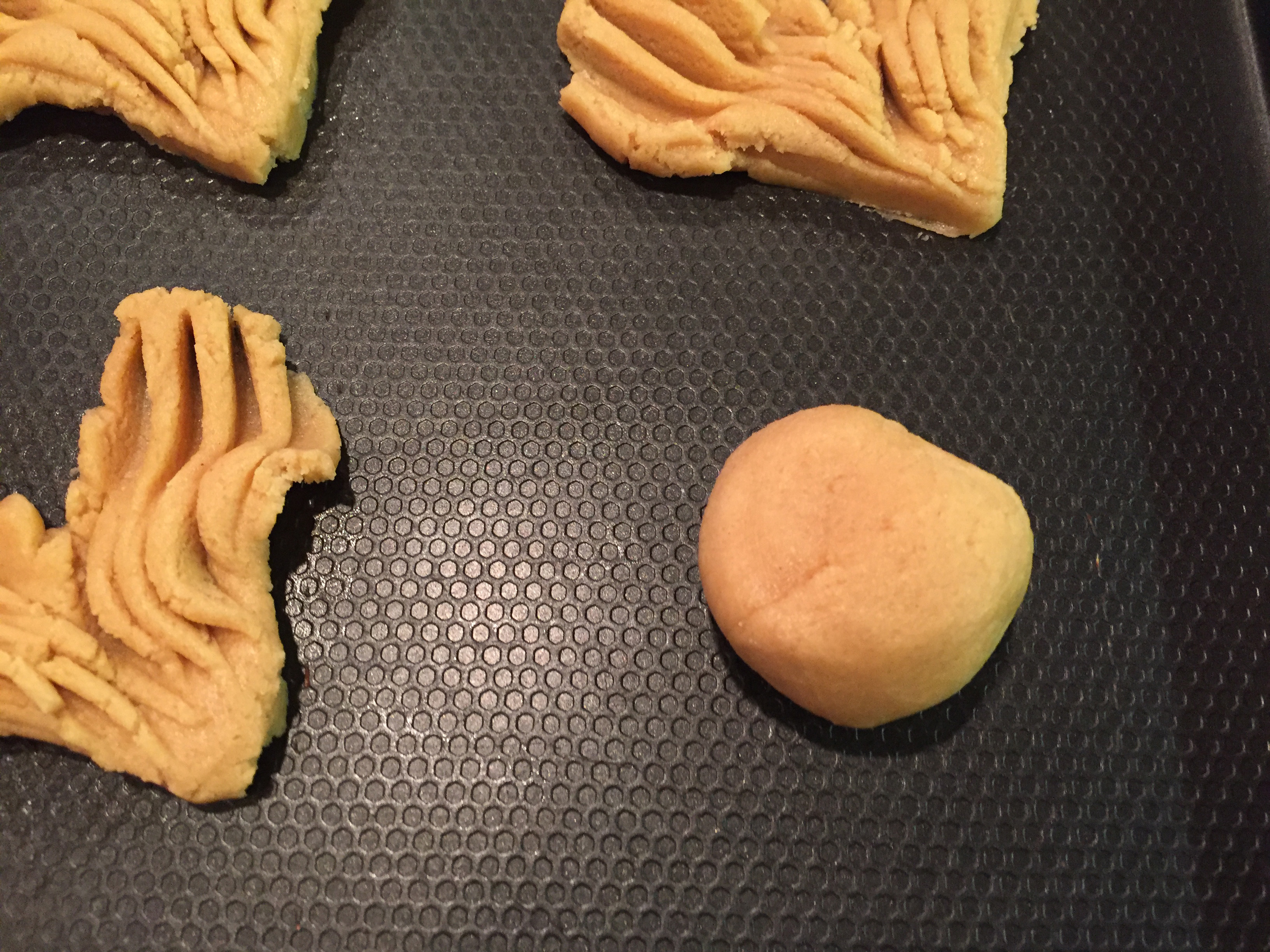Picture of Scoop Up a Small Amount of Dough and Roll It Into a Ball and Place on Cookie Sheet