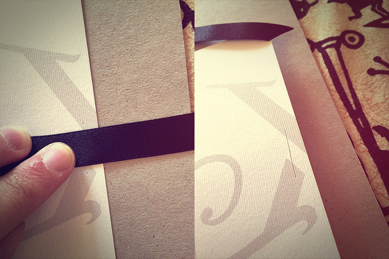 Picture of Mark a Dot a Few Mm Above and Below Your Ribbon With Your Scalpelly Thing, Then Cut a Line Between the Dots. Repeat on the Opposite Side. Don't Use a Ruler So the Cut Is Slightly Wonky.