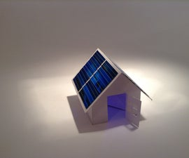 Solar-powered pop-up paper house