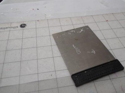 Scrape & Clean the Mat