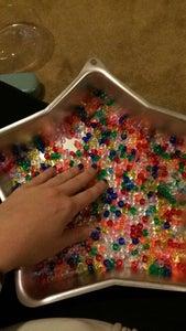 Arrange Beads in Cake Pan