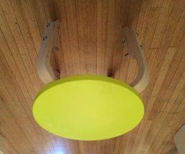 Child's adjustable-height cello stool using an IKEA Frosta stool