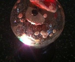 Mini Light Up Faux Snow Globe
