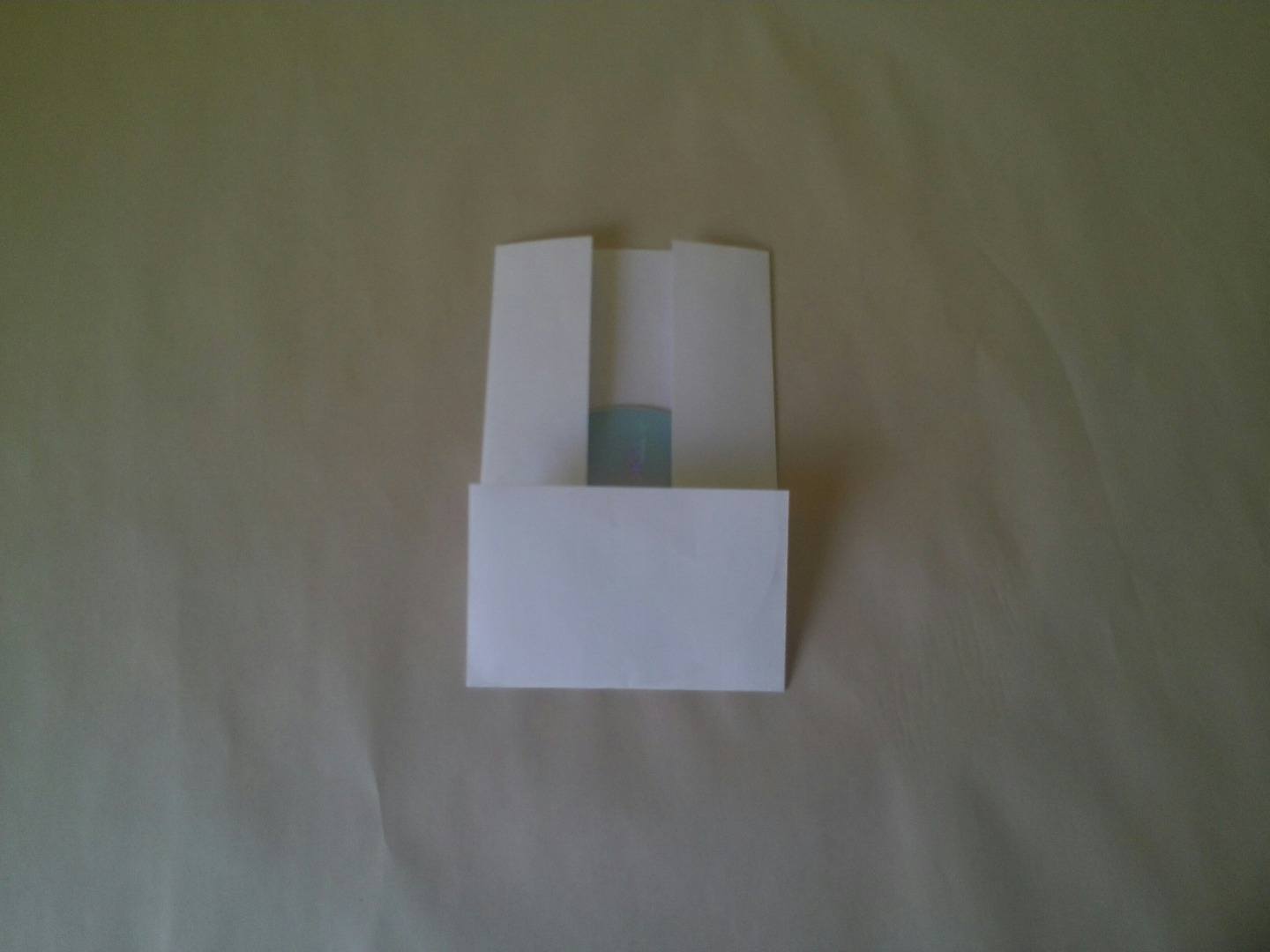 Picture of Fold Up the Entire Bottom - Try to Keep the CD in the Center.