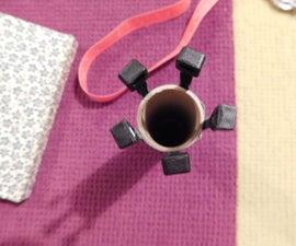 Variable-sized knitting tube using zip ties