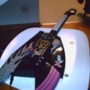 laser-synthitar from a guitar-hero-like toy guitar