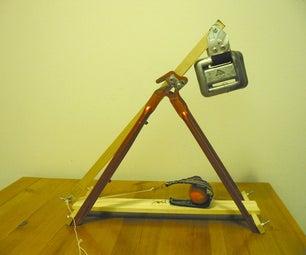 Desktop trebuchet from bicycle frame