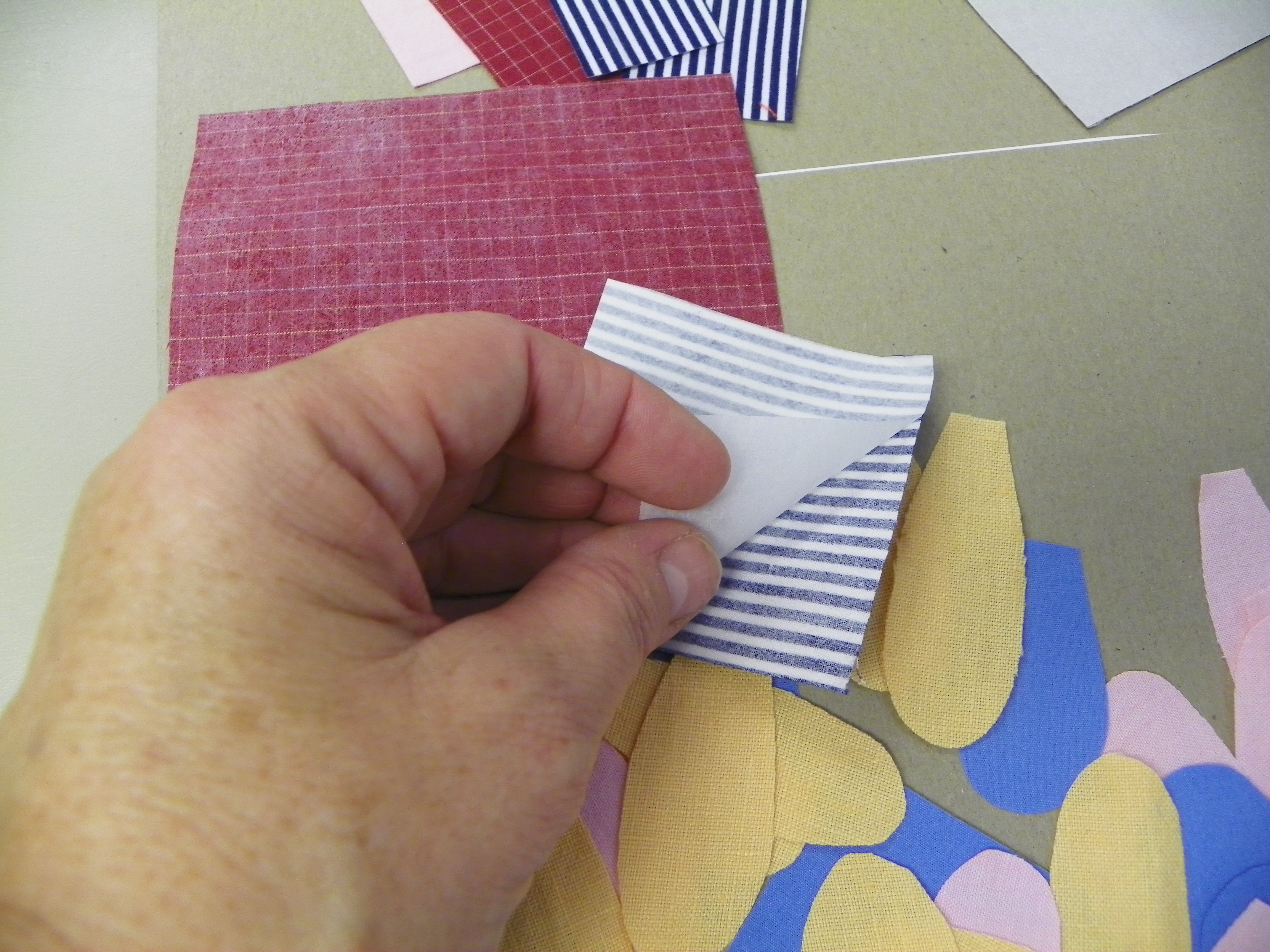 Picture of Peeling the Paper Off the Back of the Shapes