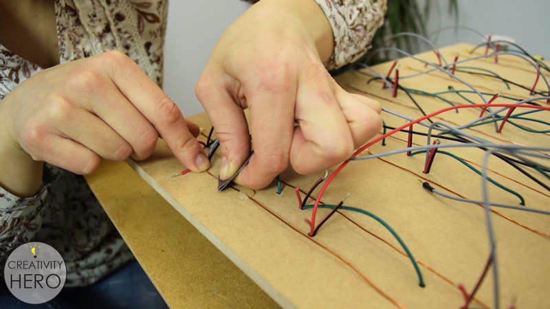 Picture of Soldering the Wires and Inserting Them Into the Arduino Board.