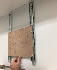 Add the TV Bracket to the Rails
