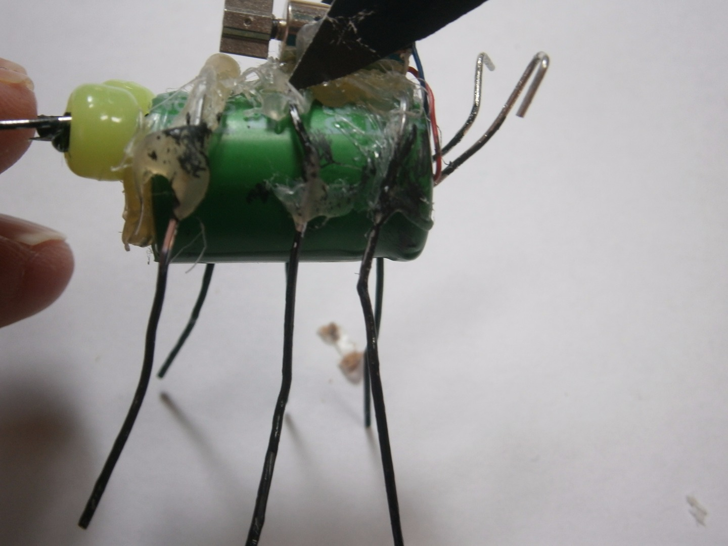 Picture of Use a Glue Gun to Glue the Legs to the Super Capacitor