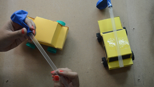 Attach Balloon With a Thick Straw With the Help of a Tape and Stick on the Top of the Car at the Center. Now the Air Powered Balloon Car Is Ready