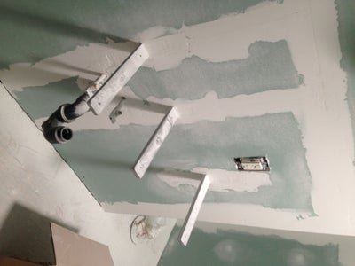 Drywall Patching and Bracket Concealment