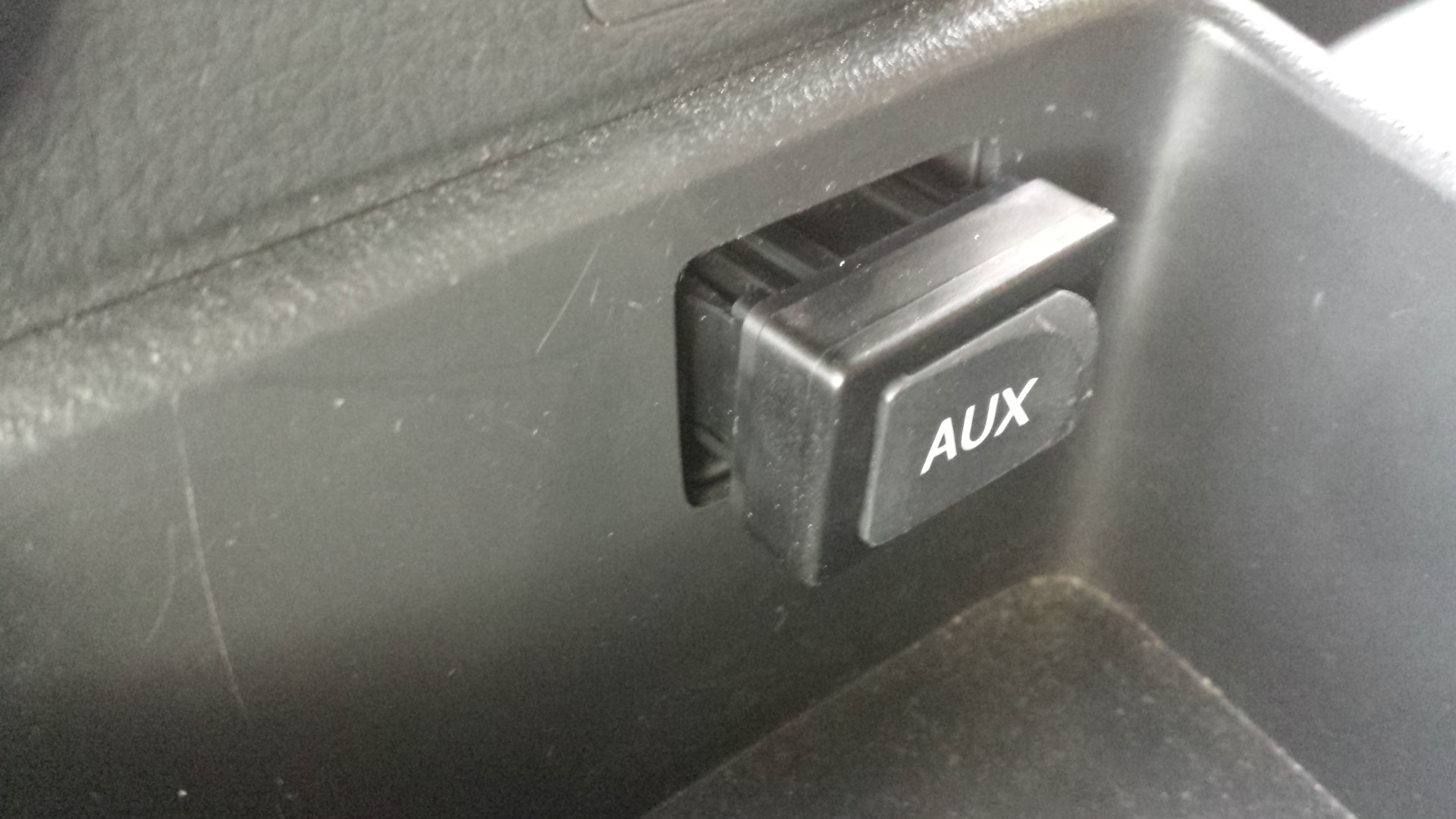 Picture of Getting Access to the AUX Connector