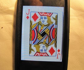 Use a NFC enabled phone to scan a fingerprint and find the selected card from a real deck of cards!