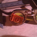 Very tiny Steampunk style goggles for very tiny fascinator hats.