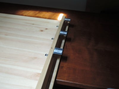 Use L Shaped Pieces to Fix the Shelf Below Your Desk
