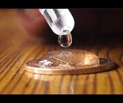 68 Drops of Water in a Coin Science Experiment