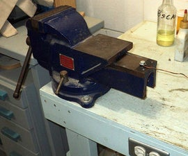 Using A Bench Vise To Easily Straighten and Strip Wire