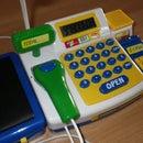 Toy cash register hack to add real bar code scanner.