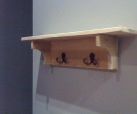 Recycled pallet coat hook board