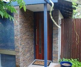 Home made hardwood door and ledgestone entry
