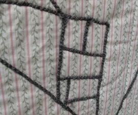 """Drawing"" on fabric with yarn (aka couching)"