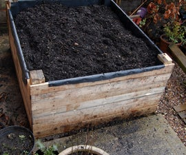 Build a raised bed out of pallets