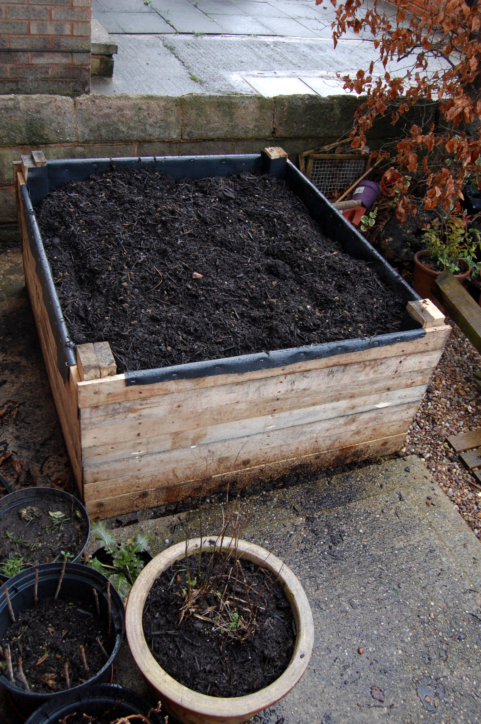 Build A Raised Bed Out Of Pallets 11 Steps With Pictures