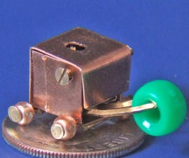 Build a Very Small Robot: Make The World's Smallest Wheeled Robot With A Gripper.
