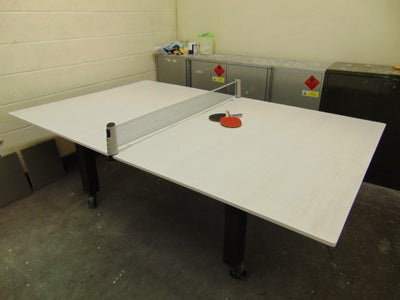 And There You Have It! a Board Room Table That Turns Into a Ping Pong Table!