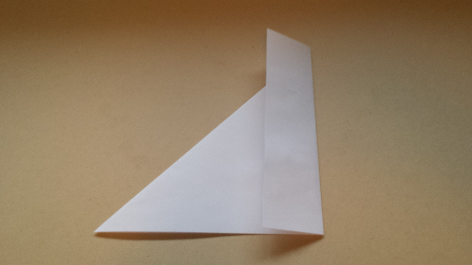 Picture of Flip Over and Fold the Excess Rectangular Strip Across Triangle Edge
